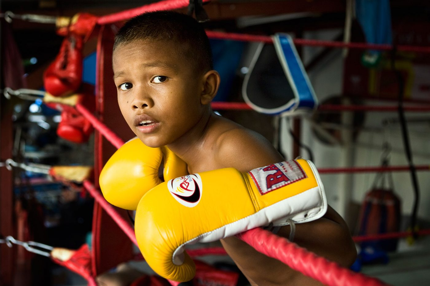 young boxer in the ring with glowes, Thailand