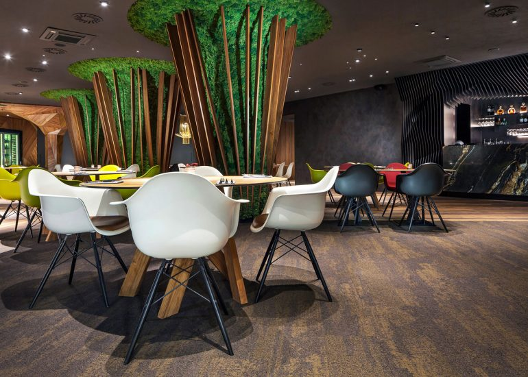 Interior photography of Signature restaurant designed by ProInterier, photographed by Roma Mlejnek. Custom carpet.